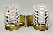 A pair of brass wall lights, with moulded