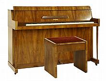 An Eavestaff walnut Pianette mini piano, 143.5cm,