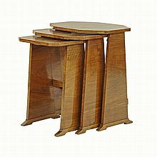 An Art Deco nest of three tables, the elongated