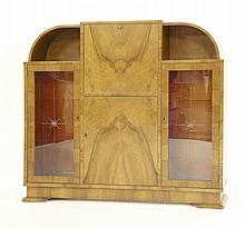 An Art Deco walnut secretaire bookcase, the