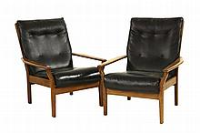 A pair of teak Cintique lounge chairs, with black