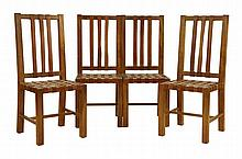 A set of four walnut dining chairs, with tan