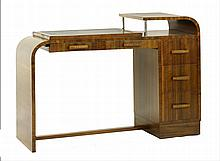 An Art Deco walnut desk, with a leather top and an