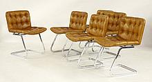 A set of six chrome and tan leather dining chairs,