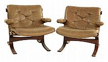 A pair of stained bentwood lounge chairs, with