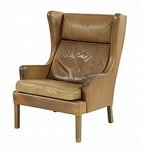 A Danish brown leather wing back armchair