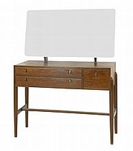 A Danish walnut dressing table, with a fixed