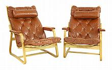 A pair of light oak bentwood lounge chairs,