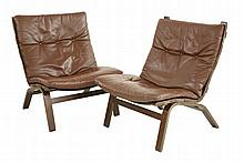 A pair of stained bentwood and leather 'Siesta'