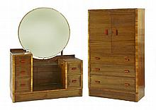 An Art Deco walnut dressing table, with a circular