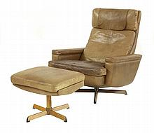 A Danish light brown leather lounge chair and
