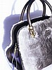 "TOD'S The D-Bag in leather and rabbit fur Adorned with a metal plate and the engraved words ""Limited edition for Stiletto"""