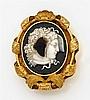 PARURE Composée d'un collier, d'une paire de pendants d'oreilles et de quatre broches ornées de dix-neuf camées ovales sur sardonyx ...