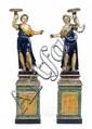 DEUX PERSONNAGES PORTE-TORCHÈRES en bois sculpté polychrome