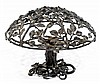 ANNÉES 30 A black laquered wrought iron table lamp usable as a hanging light. Height. 10 3/8 in. - Diam. 14 5/8 in.