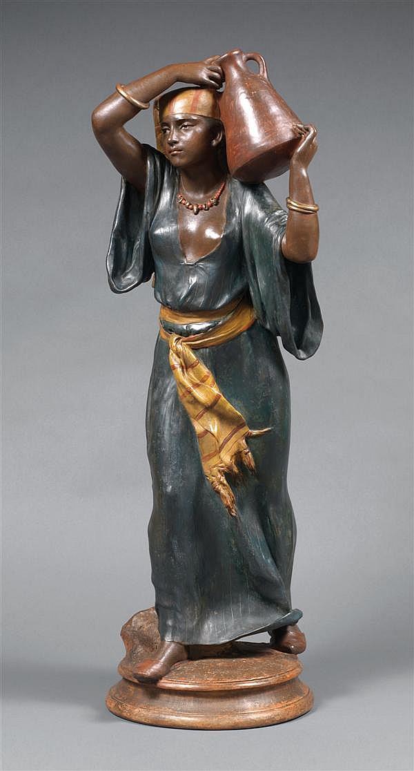 VICTORIEN ANTOINE BASTET (1852-1905) PORTEUSE D'EAU ÉGYPTIENNE Épreuve en terre cuite polychrome signée sur la terrasse et portant l...