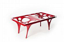 IL HOON ROH (Né EN 1978).RADIOLARIA EXPERIMENT. A red GRP (Glass Fibre Reinforced Plastic) coffee table with a rectangular thick glass