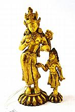 A Gilt Bronze Figure of a Goddess and Attendant,