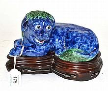 A Chinese Porcelain Figure of a Recumbent Lion
