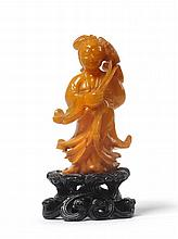A Chinese Amber Figure of Guanyin, probably late