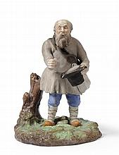 A Gardner Bisque Porcelain Figure of a Peasant,