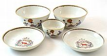 A Chinese Armorial Porcelain Tea Bowl, Two Saucers