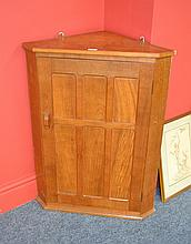 A Kingpost Woodwork Oak Corner Cupboard, with