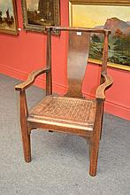 An Arts and Crafts Oak Arm Chair, with curved top