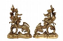 PAIR OF CHENETS - French Gilt Bronze Fireplace Chenets in the form of baroque scrollwork, supporting opposing male and female putti, wh