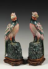 PAIR OF CHINESE PORCELAIN BIRDS - 19th c. Enameled Porcelain Phoenix Birds on Perches, in opposing stances, on custom carved wooden sta