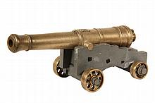 MINIATURE ENGLISH NAVAL CANNON - George III Royal Navy, War of 1812 era, in cast bronze with grey painted wooden carriage having bronze