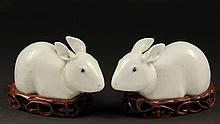 CHINESE PORCELAIN FIGURES - Fine pair 18th c. Chinese blanc de chine figures of rabbits on conforming hardwood stands. Figures are 7 1/