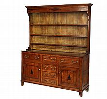TWO-PART WELSH DRESSER - Oak Cupboard with three shelf top having a deep molded cornice, inlaid fascia, plank back and molded bracket f