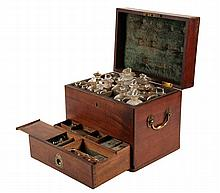 PORTABLE APOTHECARY - English Mahogany Medicinal Case with padded hinged top protecting sixteen stoppered glass bottles; plus a lower c