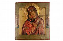 RUSSIAN ICON - Madonna and Child flanked by two Saints in the manner of the famed