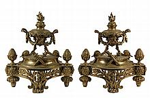 PAIR OF FRENCH EMPIRE CHENETS - Gilt Bronze, with flame finial atop two handled urn with laurel leaf swags, supported by acanthus scrol