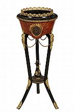 EMPIRE PERIOD WINE COOLER - French Black Lacquer and Mahogany Cooler on Tripod Base, with gilt ormolu mounts including a gallery rim, o