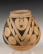 NATIVE AMERICAN POTTERY - Santa Domingo Pueblo Olla or Storage Jar, circa 1900, New Mexico, having a rounded base, with fine line overa