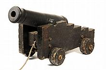 NAVAL CANNON - Early 19th c. Forged Iron One-Pounder Cannon, unmarked, on vintage four truck carriage, missing straps. 27