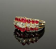 LADY'S RING - 14K Yellow Gold, Ruby and Diamond Ring designed with a center row of (7) round brilliant cut diamonds edged on either si