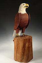 T.E. STANLEY (Contemporary Maine) - Life-Sized Bald Eagle on a Stump, carved and painted wood, signed on base. 27