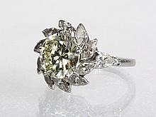 LADY'S RING - Platinum, Round Diamond and Marquise Diamond Flowerhead Ring, ca 1950, set with a round brilliant diamond with ten marqu
