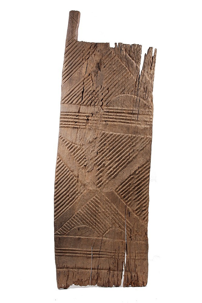 EARLY AFRICAN DOOR - Igbo Peoples, Southeast Nigeria, Carved Door Panel in Iroku Wood, 18th - 19th c, with incised decoration. From a s