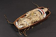 NATIVE AMERICAN DOLL & BASKET - Northern Plains Indian Child's Doll in deer hide, with real hair, beaded decoration and features, 11 1/2