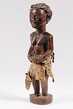 AFRICAN FIGURE - Small Luba Standing Figure of Woman holding basket, with real hide skirt and fibre belt, plaited hair with receptacle in top. Carved hardwood, 19th c. 11