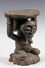 AFRICAN STOOL - Luba People, Congo, Chief's Stool, with edge decorated seat supported by kneeling female figure, with elaborate coiffure, scarification, fibre belt, on integral base, 19th c. 10 1/2