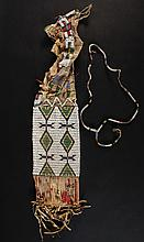 LAKOTA PIPE BAG - 19th c Beaded Deerhide Bag with fully beaded band of crosses, field of spirit figures, rolled edge and cord, remnants of quilled fringe