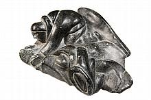 INUIT STONE CARVING - Large Greenstone Figural Group of an overnight encampment, the man providing for the woman, who is in her bedroll, marked '393' on underside, roughly 4
