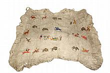 NATIVE AMERICAN PAINTED PICTORIAL HIDE - Plains Indian Painted Buffalo Hide (Tatanka) Tipi Drape, late 19th c, with four ranks of figures surrounding a central Tipi, narrating deer, bear and buffalo hunts, dances, a h...