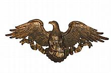LARGE EAGLE PLAQUE - American Eagle, spreadwing, facing left, with riband and shield, in fiberglass and plaster over a wooden backboard, painted in faux verdigris with gilding. 36